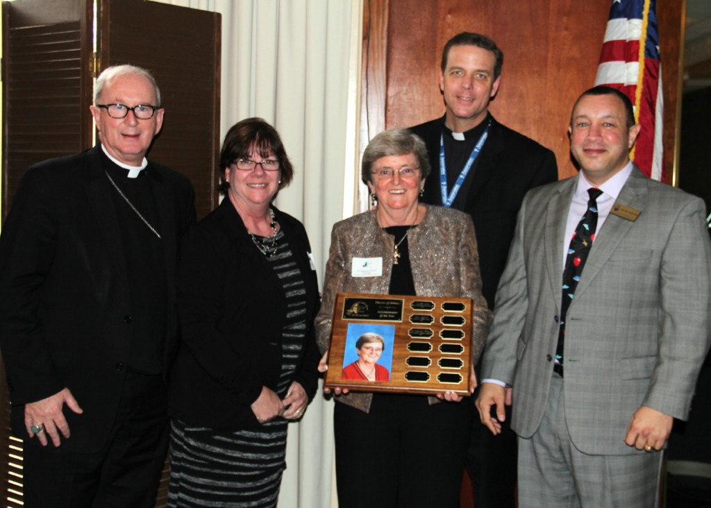Bishop Noonan, Mrs. Del Rey, Dr. Curran, Fr. Parkes and Superintendent Henry Fortier